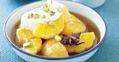 Sweet poached mandarins are enhanced by the sweet syrup and cardamom cream topping.