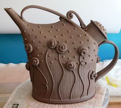 Great example of a well thought out design- the form resembles a watering can, and the decoration supports the design