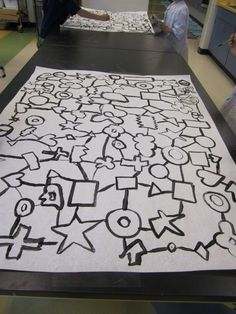 start with black shapes - no touching - connect with lines - kids get one color - walk around and paint shapes - go over lines with black again for pop
