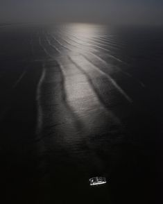 Photo by @woods_galimberti @gabrielegalimbertiphoto - A moonlit view of the tide coming in, seen from the 66th floor of the Trump Ocean Club. A luxury yacht, owned by the complex, is anchored just in front, awaiting clients who might wish to go the hotel's private beach in the Pearl Islands, about an hour away. It boast luxury residences, a hotel, swimming pools, multiple restaurants, fitness centers, a high-end retail arcade, and Panama City's only private pier. #panama #panamacity…