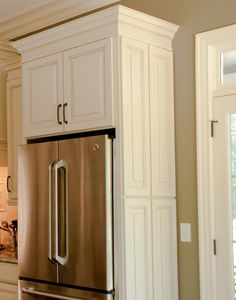 """CliqStudios' decorative doors may be used to """"dress up"""" or customize the look of the end run of cabinetry or the backside of islands and peninsulas. Face frames with doors are also available to hide utility panels or to create the look of a built-in pantry."""