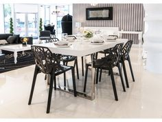 Flora Black Dining Chair  Market Price: $260.00  Our Price: $129.00