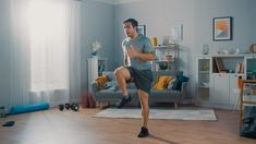 Strong Athletic Fit Man in T-shirt and Shorts is Energetically Jogging in Place at Home in His Spacious and Bright Living Room with Minimalistic Interior. - Buy this stock photo and explore similar images at Adobe Stock Thigh Toning Exercises, Toning Workouts, Weight Workouts, Fitness Workouts, Fitness Goals, Fitness Tips, Jogging In Place, Brisk Walking, Walking Exercise