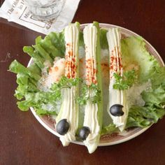Stuffed Celery Recipe - Saveur.com - an oldie but goodie from way back.  Holiday tables weren't the same without them.