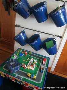 DIY Wall LEGO Storage at B-InspiredMama.com plus TONS of tips for storing children's Toys.