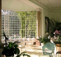 these multi-paned windows create the effect of lattice in this garden room...