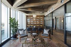 Marshall Wace Asset Management's office in London feel like a lavish private apartment with its reclaimed wood ceilings, antique industrial lighting and family photomontages.