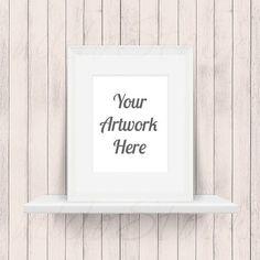 d5f3f120766 White Frame on Shelf for Wall Art Display Mockup Wood by UddoStock