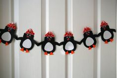 Penguin Paper chain... good decorate one as each character in Tacky!