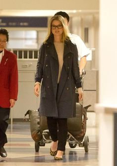 Alice Eve is all smiles as she arrives at LAX (Los Angeles International Airport) on Jan 5, 2013