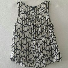 Black and White Racerback Tank Can fit medium, flowy, discounted when bundled :) I also sell on the app Vinted, where shipping is cheaper Forever 21 Tops Tank Tops
