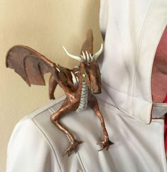 Whether you're a fan of Anne McCaffrey or George R. R. Martin, you need a little dragon on your shoulder. This one is fairly simply made using a wire armature, foil,...