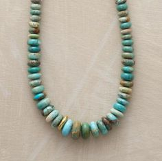 Turquoise Tour Necklace Turquoise rondelles  lead a guided tour of the stone's many variations. They swell slightly as they approach the midpoint; three 14kt gold vermeil beads are unevenly dispersed.