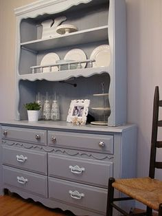 """I want a hutch more or less like this for the kitchen.  Needs to have the working surface on top of the """"dresser"""" part, as we don't have much counter space.  I'd put pots and pans in the drawers."""