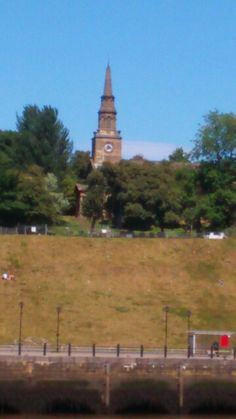 Church tower in Newcastle from the other side of the river Tyne in Gateshead