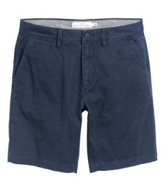 Chino shorts in washed cotton twill. Zip fly, side pockets, coin pocket, and welt back pockets with button. Regular fit.
