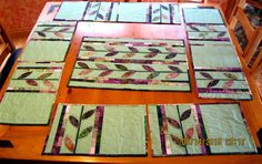 Laura Ricks shared her beautiful modified Fallen Leaf table runner and place mats from a pattern by Happy Stash Quilts.