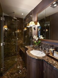 Elegant bathroom tile design. Speakingof grand bathroom tiles, this granite finish is a very elegant design for bathrooms. The bathroom tile pattern works with big as well as small bathrooms.