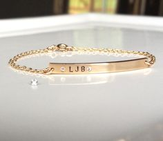 Nameplate Bracelet - Personalized Gold Bar Bracelet  - Tiny Diamond Name Bar Bracelet - Skinny Bar - Custom Stamped - Gold ID Bracelet by GoldCrushJewelry on Etsy https://www.etsy.com/listing/194528749/nameplate-bracelet-personalized-gold-bar