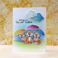 PPP-Fox Friends & Rainy Day.  used one of the Scallop Border dies for the grass. The Rainy Days & Rainy Day Additions sets were also used for the umbrellas, clouds & sentiment. I inked up the umbrellas & clouds with two colors each to give them a gradient look using Mama Elephant inks.