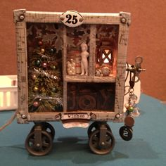 Some lucky folks got to make this in the Tim Holtz workshop. So cute!