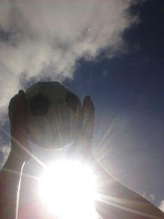 Soccer ball and sun