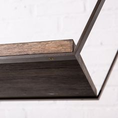 Both the Hanging Strap Shelf and the Posting Strap Support don patinated steel straps that support solid oak shelves.