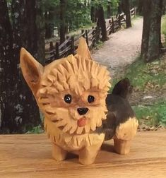 This is a handmade Yorkshire Terrier puppy Yorky art sculpture for a shelf home decoration. The puppy is standing on a window sill looking at the woods outside. This would be a great decoration for your own home or on a shelf in a childs room. The puppy is just over 3.5 inches