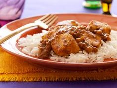 Bal's No-Butter Chicken - Unlike creamy curries and other high-calorie Indian dishes, this chicken gets its flavor (and there's plenty of it) from a mixture of spices and aromatics and just a dash of low-fat yogurt.
