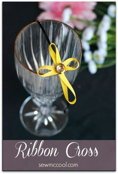 Learn how to make an elegant ribbon cross from just a piece of ribbon and a button! Add to a headband or clip for a great hair accessory, by sewmccool.com.