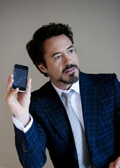 Robert Downey Jr. and his iPhone 3G (he did the voiceover for the product-launch commercial) c. 2008