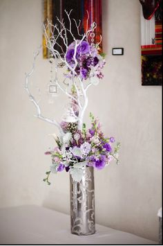 Purple and crystal branch centerpiece- love this one!