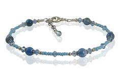 Handcrafted, adjustable 9 - 9 1/2 inch aqua blue gemstone beaded anklet created with turquoise blue seed beads, aqua Swarovski Austrian crystals, aqua agate gemstones, Bali 925 silver and sterling sil