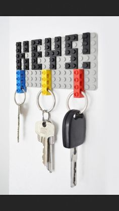 mount lego board to wall with command strips. loop legos to keyrings. stick keys onto board when i'm home.