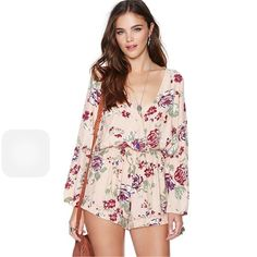 Rose Romper Length: Short Jumpsuits Material: Chiffon Color: PRINTED Featured:Ruffles, deep V,  elastic waist, Long sleeve, back exposed This jumpsuit is featured with sexy design, high quality of material.  true Size M Dresses Mini