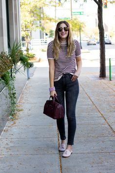 casual fall outfit perfect for work or weekend — striped sweater, high rise jeans and tassel mules