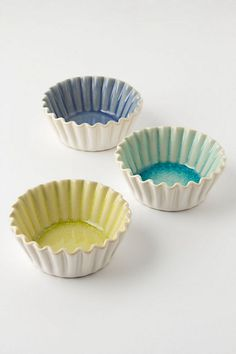 Crinkled Mini Baker at Anthropologie.com - these would be great for making Peanut Butter Cup Cakes and such.  Very cute!