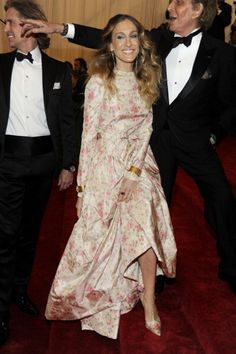 Fashionista Sarah Jessica Parker wore a floral patterned dress with matching shoes on the red carpet of the MET Gala in NYC. See full gallery here: http://bit.ly/ISkhB2