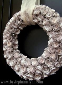 Paper rosette wreath made from recycled book pages