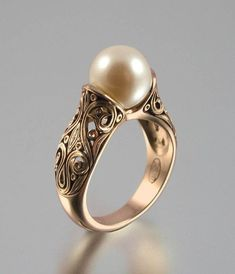 Vintage Rings Gold Pearl Ring A genuine gold pearl. Set in oxidized silver. Stunning Pearl Ring Gold as 1576 Vintage Pearl And Diamond Engagement Rings Pearl Jewelry, Antique Jewelry, Gold Jewelry, Jewelery, Vintage Jewelry, Jewelry Accessories, Fine Jewelry, Pearl Rings, Sapphire Jewelry