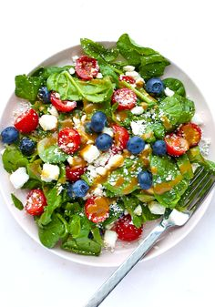This fruity Tomato and Feta Salad is a perfectly patriotic piece for the sides table at your next backyard picnic! // Mix 1 c blueberries, 1 c halved cherry tomatoes, 1 c crumbled feta with 2 c chopped baby spinach leaves. Toss with a well-shaken mixture of 3 tbsp olive oil, 2 tbsp white wine vinegar, & 1 tsp Dijon mustard. Salt and pepper to taste, & serve immediately.