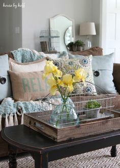 Wire basket in wood tray, Yellow flowers in clear green vase and a succulent. (I love this look.)Summer Home Tour 2015 - House by Hoff