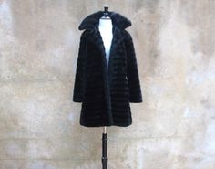 Hey, I found this really awesome Etsy listing at https://www.etsy.com/listing/160393611/vintage-50s-black-faux-fur-coat-1950s