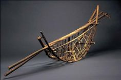 """"""" Dorothy Gill Barnes Long Handled Banyan Basket, 1988 Born Strawberry Point, Iowa 1927 shaped, woven, and assembled banyan and red spruce bark 16 x 52 3/4 x 9 1/2 in. (40.6 x 134.0 x 24.1 cm)..."""