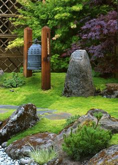 Love the moss carpet around the upright stones with the different colored Japanese Maple trees in the background.