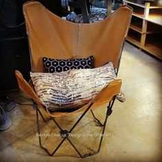 Leather butterfly chair with fun accent pillows https://www.instagram.com/p/BET3TIRLG0q/