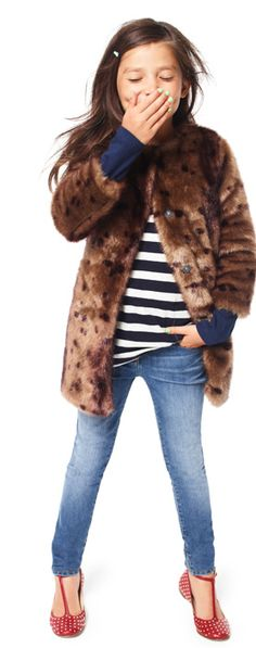 Textures and patterns and layers   Fur leopard, stripes, skinny jeans, read studded shoes.