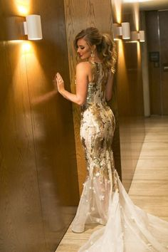 The bride changed into a gold reception dress to match the wedding cake. | Photo: Blumenthal Photography, Australia
