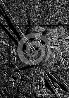 Shot in black and white, detail on an sculpture representing some warriors placed on a square on the street, set in Stockholm, Sweden, Europa, Europe