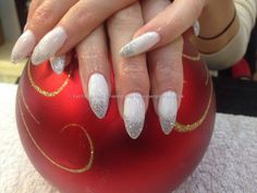 Acrylic nails with white gelish gel polish and silver glitter dust